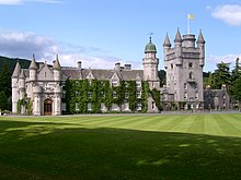 View of Balmoral Castle showing the Royal Standard of Scotland flying from the rooftop flagpole, indicating that Her Majesty The Queen is not in residence.