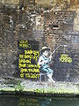 Banksy -fisherman mural -Regents Canal, Camden, London-26April2010.jpg