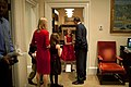 Barack Obama greets a family in the Oval Office secretary office.jpg