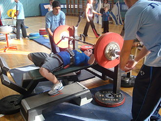 "Bench press - A female athlete performing a bench press at the IPA world championship 2007, in the ""Bench Only"" category"