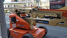 A JLG brand articulating boom lift rented from BlueLine Rental.