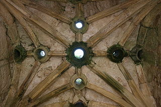 Murder hole hole in the ceiling of a gateway or passageway
