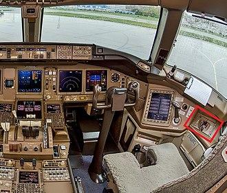 Emergency oxygen system - A 777-300 cockpit highlighting oxygen supply mask location