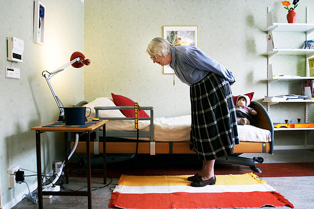 elderly woman in room