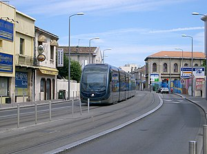 Ground-level power supply - Bordeaux tram using APS on route B near the Roustaing tramstop