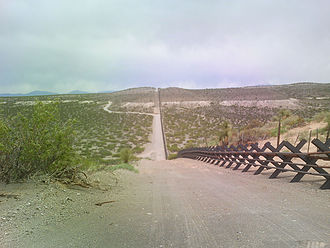 Mexico–United States border - Vehicle barrier in the New Mexico desert