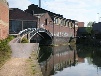 Bordesley Junction - The main line to Warwick through Camp Hill Locks is straight ahead. The bypass to Salford Junction turns under the towpath bridge.