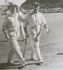 Don Bradman and Sid Barnes walk from the field in 1946