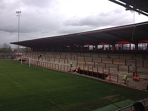 Drill Field - The steel and concrete from the Dane Bank Stand was recovered and used to build the St. Mary's Road End at Broadhurst Park.