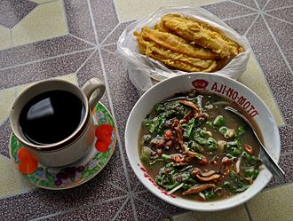 Bubur pedas - Bubur pedas served with pisang goreng and a cup of coffee served in Sambas, West Kalimantan, Indonesia.