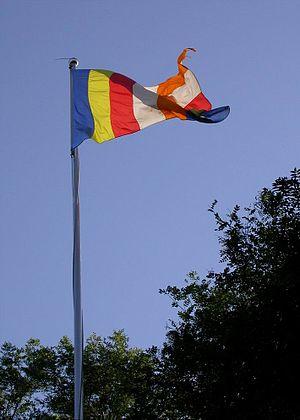 Buddhist flag - A Buddhist flag flying upside down in Beijing.