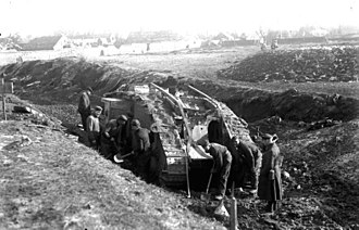Battle of Cambrai (1917) - German soldiers recovering a British Mark IV tank