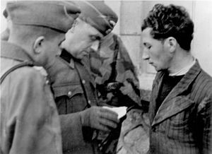 "Francs-Tireurs et Partisans - A captured Resistance fighter in 1944. The German caption says ""This communist leader is on the wanted list ... his papers prove his affiliation with terrorist groups."""