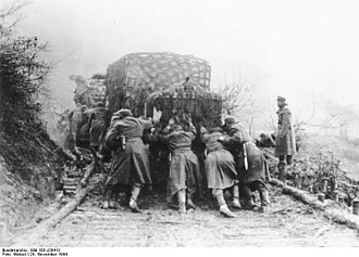 Corduroy road - In war, corduroy roads are often used as an emergency measure where poor quality roads have been damaged by the large numbers of vehicles or troops that have passed over them. Seen here are Germans in Yugoslavia in 1944.