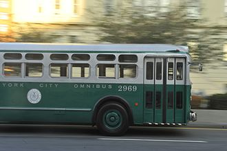 "New York City Board of Transportation - A GM ""old-look"" transit bus bearing the original green and white color scheme of the Board of Transportation, and a white circular BOT logo. The color scheme would be inherited by the Transit Authority."