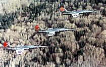 CF-104 Starfighters of 417 Sqn in flight near Cold Lake 1976.jpg