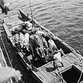 COLLECTIE TROPENMUSEUM Japans landingsvaartuig uit de Tweede Wereldoorlog langszij de ms. Karaton voor het laden van runderen TMnr 10028493.jpg