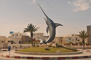 Mahdia Governorate - Swordfish on a roundabout in Mahdia.  The tourist industry is reflected in the area by luxury accommodation, restaurants and impressive works of art.