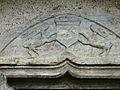 Caubous (31) église porte tympan.jpg