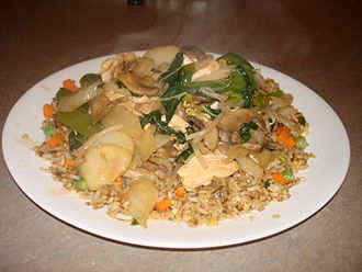 American Chinese cuisine - Chop suey, made with garlic chicken and peapods, on fried rice