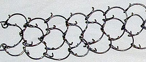 Controversies about Opus Dei - Closeup of a cilice—a small metal chain with inwardly pointing spikes