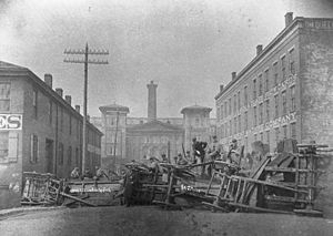Cincinnati riots of 1884 - The first barricade, hastily built on Court Street