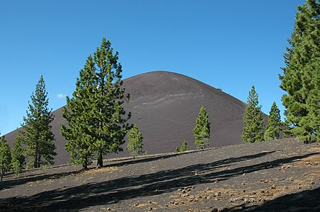 View of Cinder Cone, Lassen Volcanic National Park, California, from the Cinder Cone Trail that leads to it. The trees surrounding the volcano, are Jeffrey Pines (Pinus jeffreyi).