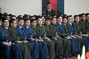 National Military Academy of Afghanistan - The class of 2010 listens as President Hamid Karzai gives a speech during their graduation ceremony in March 2010