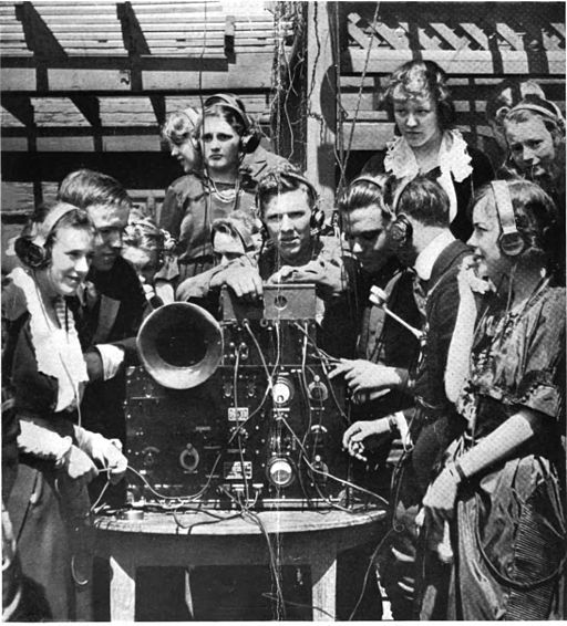 Club holds radio dance wearing earphones 1920