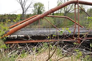 Coleman Bridge (Windsor, Massachusetts) - Detail of bridge; note beaver dam underneath structure