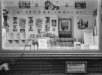 """History of the Communist Party USA - Communist Party USA bookstore in September 1942, with the pro-war slogan """"A Second Front Now""""."""