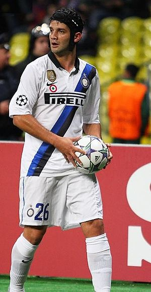 Cristian Chivu - Chivu playing for Inter in 2011, wearing his protective headguard