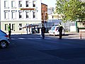 Děčín, městská policie řídí přechod před hlavním nádražím.jpg