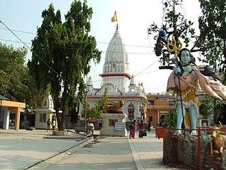 Daksha yajna - Daksheswara Mahadev Temple with Shiva carrying Sati's corpse (rightmost).