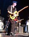 Darren Thiboutot Jr. performing with Buddy Guy and his band.jpg