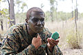 Defense.gov News Photo 101012-M-9232S-040 - U.S. Marine Corps Lance Cpl. Michael Ellmer assigned to Alpha Company 1st Battalion 3rd Marine Regiment applies camouflage paint during.jpg