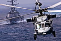 Defense.gov News Photo 120102-N-DR144-050 - An MH-60S Knight Hawk helicopter passes the USS Chafee DDG 90 while delivering supplies to the USS Carl Vinson CVN 70 during a vertical.jpg