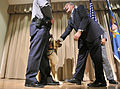 Defense.gov News Photo 120502-D-NI589-0355 - Secretary of Defense Leon E. Panetta pauses to greet a police dog after being given the Bravo Award by Deputy Director of the Pentagon Force.jpg