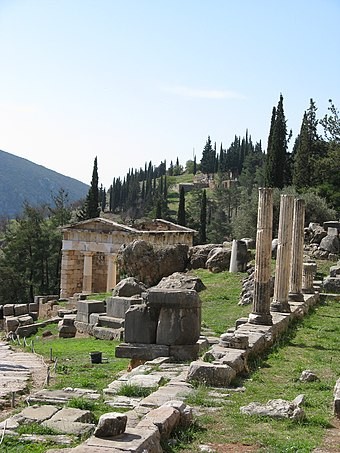 View of the Athenian Treasury; the Stoa of the Athenians on the right. Delphi-2.jpg