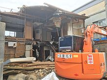 The Demolition Of A Wooden Suburban House In Japan.
