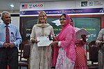 Deputy Director USAID Punjab Maggie Schoch presenting scholarship certificates to students under USAID's Merit and Needs Based Scholarship Program. (18491545338).jpg
