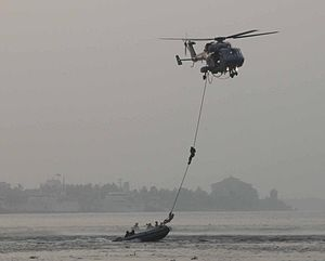 Special Forces of India -  HAL Dhruv helicopter of the Indian Navy extracting Marine Commandos (MARCOS)