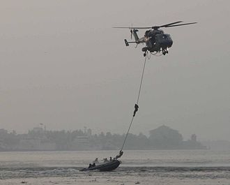 MARCOS - HAL Dhruv helicopter of the Indian Navy extracting Marine Commandos (MARCOS) on Navy day 2013 at Kochi.