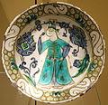 Dish with a man smelling a flower, Turkey, Iznik, c. 1600, underglaze-painted stonepaste - Royal Ontario Museum - DSC04732.JPG