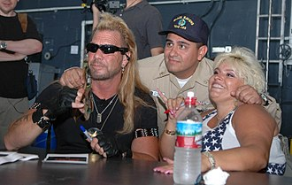 Duane Chapman - Dog and Beth Chapman signing autographs during a visit aboard the nuclear-powered aircraft carrier USS Nimitz on May 20, 2005 Pearl Harbor, Hawaii