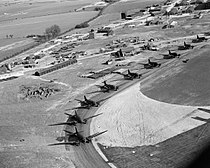 Douglas Dakotas of No. 233 Squadron RAF lined up on the perimeter track at Blakehill Farm, Wiltshire, for an exercise with the 6th Airborne Division, 20 April 1944. CH12833.jpg