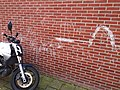 Drawing on the brick wall - street art in Amsterdam.jpg