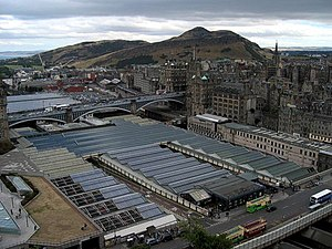 Edinburgh Waverley railway station - View from Scott Monument of Waverley Station roof, prior to restoration, between Waverley Bridge (bottom right) and North Bridge, and Arthur's Seat in the background