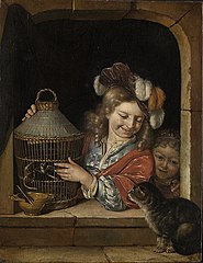 Two children with a cat and birdcage in a window