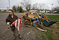 FEMA - 34774 - Resident stands in front of a debris pile in Missouri holding a flag.jpg